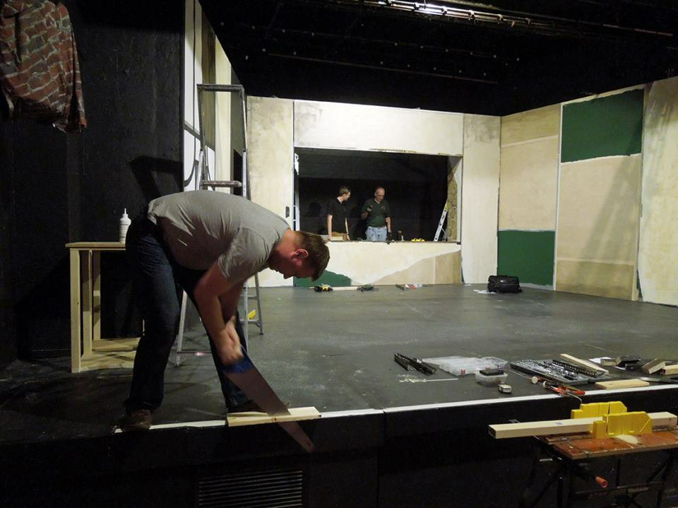 Graeme frantically sawing on the get-in for God of Carnage, 2013