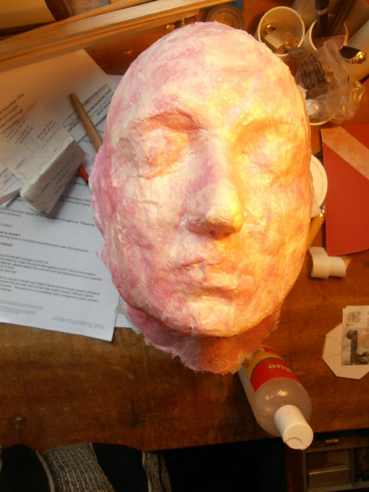 The replica head emmerges from the mould for Anne Boleyn, 2013